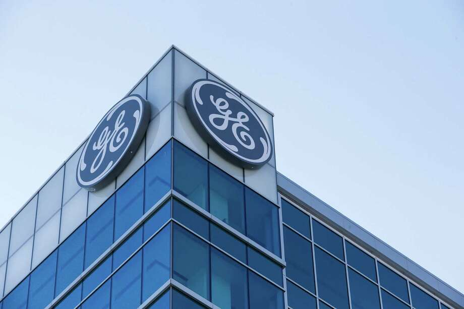 FILE- In this Jan. 16, 2018, file photo, the General Electric logo is displayed at the top of their Global Operations Center in the Banks development of downtown Cincinnati. General Electric is joining with Wabtec Corp. in a cash-and-stock deal as part of a move to help bolster its transportation unit. Photo: John Minchillo /Associated Press / AP