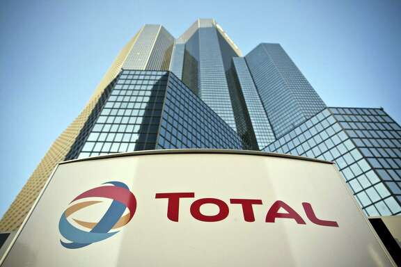 The Total SA company sign is seen outside their headquarters in the La Defense business district in Paris, France. French energy company Total says it is looking to expand its search for natural gas off Cyprus' south coast and seeks to secure another exploratory drilling license, days after warning it could exit Iran over renewed U.S. sanctions there.