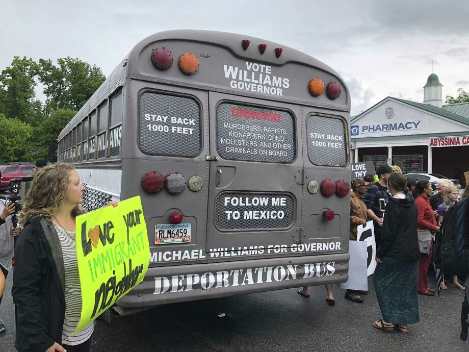 "Georgia gubernatorial candidate Michael Williams, a Republican, is touring the state in a ""deportation bus."" Trump has created a climate in which such offensive acts get ever closer to mainstream acceptance, either outright or by refusing to condemn them. Photo: Benjamin Nadler /Associated Press / AP"