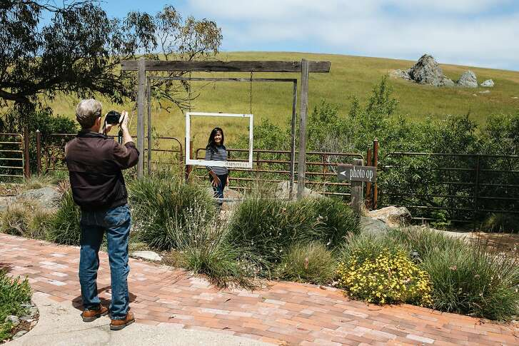David George takes a picture of his wife, Teodora George, the photo op frame in Harmony, Calif., Saturday, May 19, 2018.