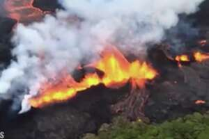 The U.S. Geological Survey released video footage taken from the air Monday, showing fountains of lava feeding a massive river of red-hot, bubbling molten rock flowing toward the ocean.