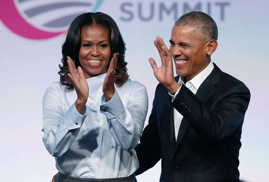 (FILES) In this file photo taken on October 31, 2017, former US President Barack Obama and First Lady Michelle Obama arrive at the Obama Foundation Summit in Chicago, Illinois. Barack and Michelle Obama have entered into a multi-year agreement to produce films and series with Netflix, the world's leading internet entertainment service announced on May 21, 2018. The former first couple have launched Higher Ground Productions to produce a variety of content for the video streamer, possibly including scripted series, documentaries and features.  / AFP PHOTO / Jim YoungJIM YOUNG/AFP/Getty Images Photo: JIM YOUNG, AFP/Getty Images