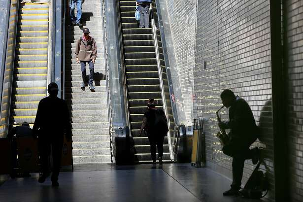 Commuters and artists pass through Civic Center Bart station on Monday, May 21, 2018 in San Francisco, Calif.