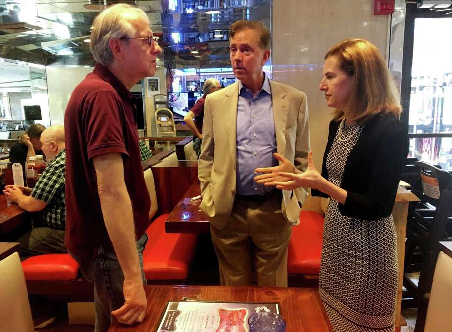 Greenwich businessman Ned Lamont, center, the endorsed Democratic candidate for governor, and former secretary of the state Susan Bysiewicz, who was endorsed for lieutenant governor, speak with Patrick Vingo, left, a Norwalk resident and vice president of the advocacy group Parents and Friends of Lower Fairfield Respite Center at the Silver Star Diner in Norwalk. Photo: Kaitlyn Krasselt / Hearst Connecticut Media / Norwalk Hour