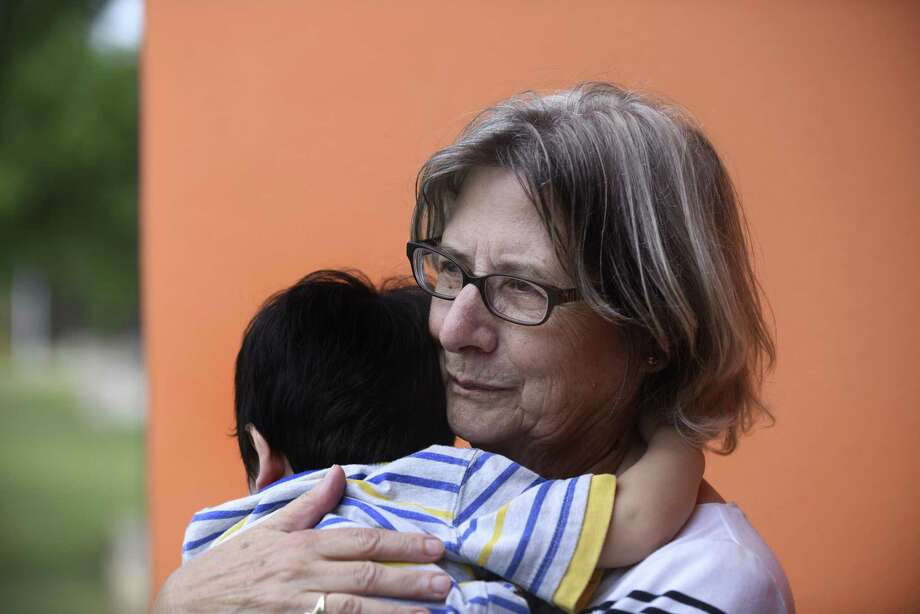 Leila Hileman holds a child at The Children's Shelter, where she is one of about 150 volunteers who help care for children who are often victims of abuse, abandonment and neglect. Tuesday, May 15, 2018. Photo: Photos By Billy Calzada / San Antonio Express-News / San Antonio Express-News