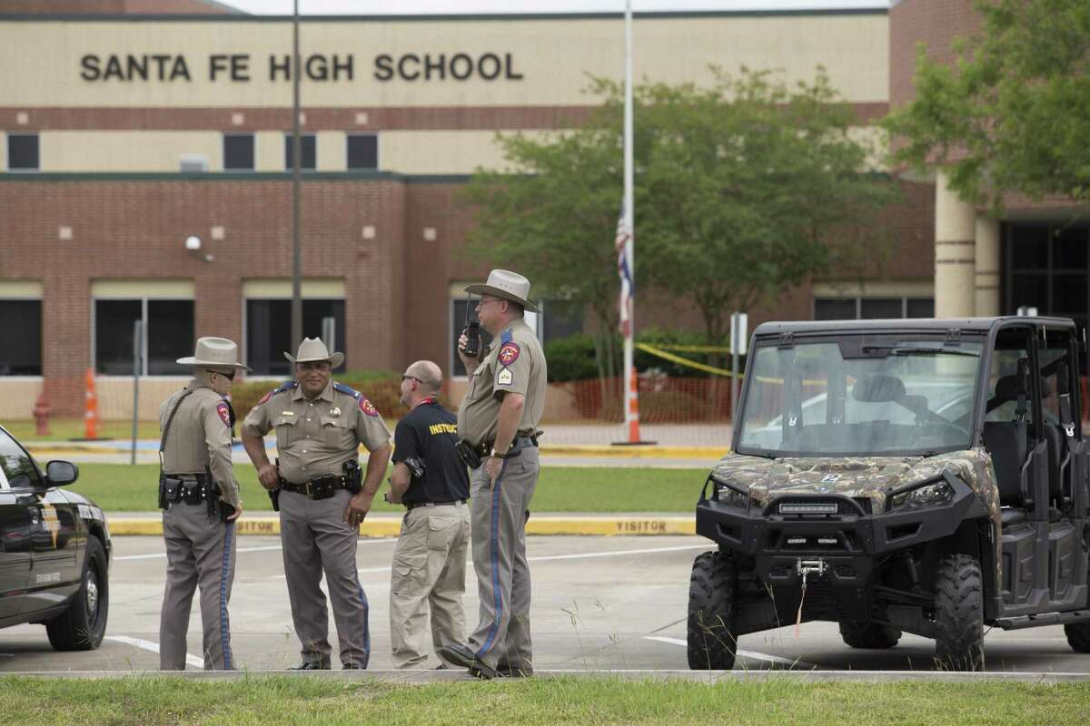 Police officers at Santa Fe High School in Santa Fe, Texas, May 20, 2018. A gunman killed 10 people and wounded 13 others at the high school on Friday.
