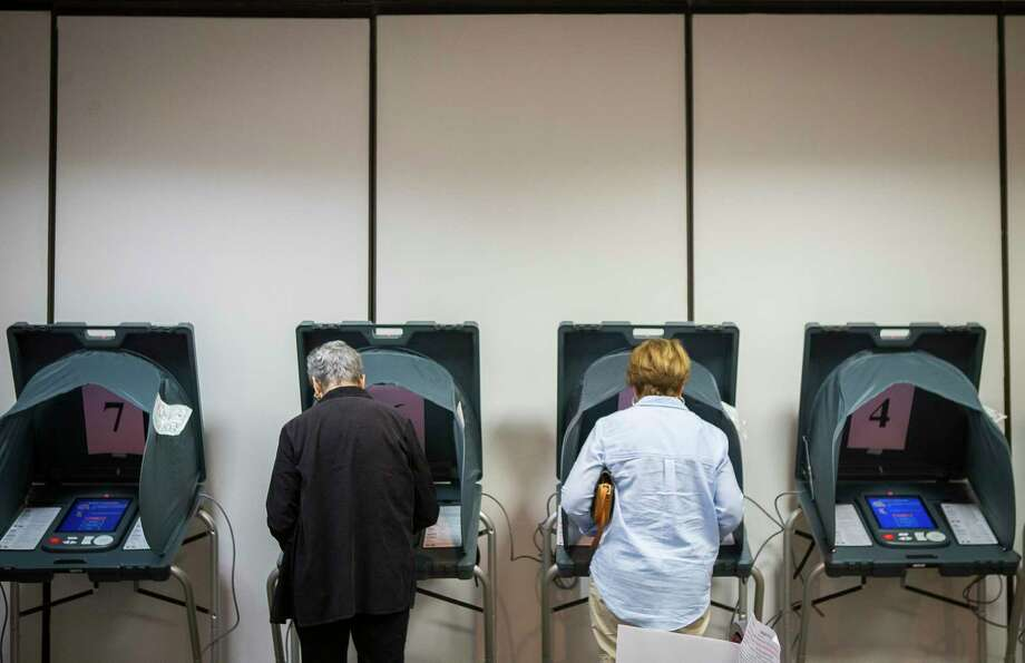 Voters use voting machines inside the Republican primary polling location at the Four Points by Sheraton on the Southwest Frwy at Wakeforest Drive, Tuesday, March 6, 2018, in Houston. ( Mark Mulligan / Houston Chronicle ) Photo: Mark Mulligan, Houston Chronicle / Houston Chronicle / © 2018 Houston Chronicle