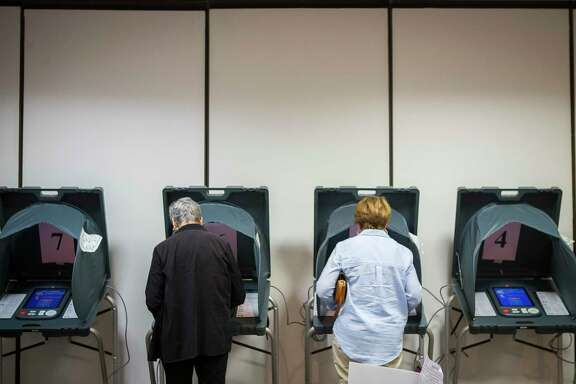Voters use voting machines inside the Republican primary polling location at the Four Points by Sheraton on the Southwest Frwy at Wakeforest Drive, Tuesday, March 6, 2018, in Houston. ( Mark Mulligan / Houston Chronicle )