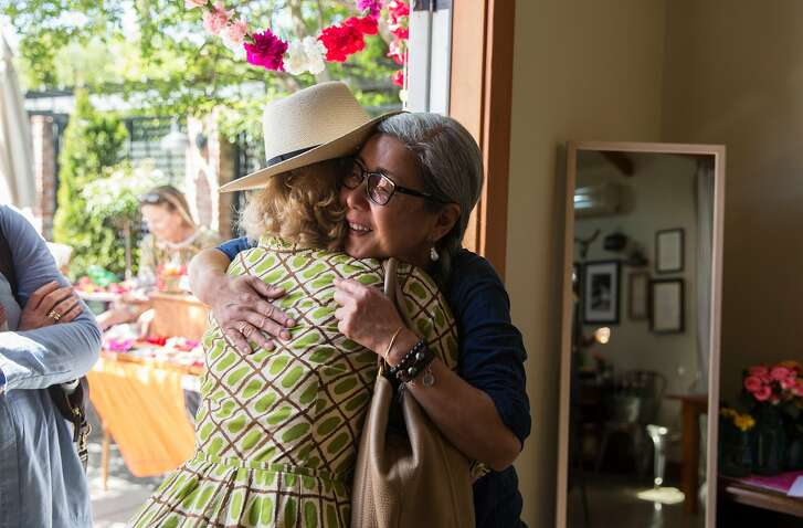 Susan Kim, SF Bay Makers founder and owner of My Dear Tejas, hugs a friend as she arrives at a pop-up marketplace event with SF Bay Makers Saturday, April 21, 2018 at Elizabeth Spencer Winery in Rutherford, Calif.