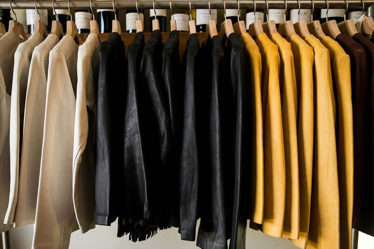 A full rack of leather jackets made by Susan Kim of My Dear Tejas sit on display during a pop-up marketplace event with SF Bay Makers Saturday, April 21, 2018 at Elizabeth Spencer Winery in Rutherford, Calif.