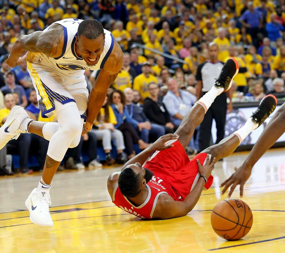 Golden State Warriors' Andre Iguodala reacts to banging knees with Houston Rockets' James Harden in 4th quarter during NBA Western Conference Finals Game 3 at Oracle Arena in Oakland, CA on Sunday, May 20, 2018. Photo: Scott Strazzante / The Chronicle