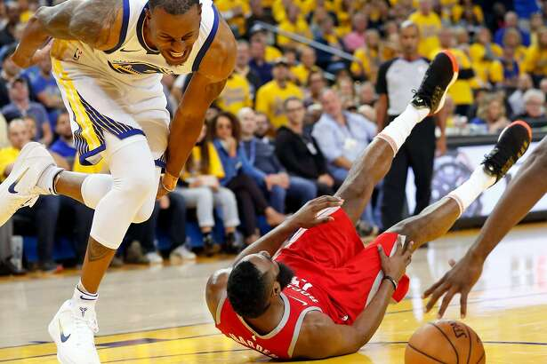 Golden State Warriors' Andre Iguodala reacts to banging knees with Houston Rockets' James Harden in 4th quarter during NBA Western Conference Finals Game 3 at Oracle Arena in Oakland, CA on Sunday, May 20, 2018.