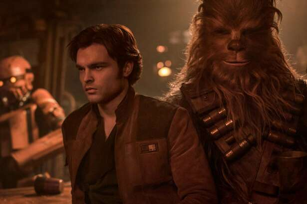 "Alden Ehrenreich as Han Solo, with Chewbacca (Joonas Suotamo), in ""Solo: A Star Wars Story.""(Lucasfilm)"