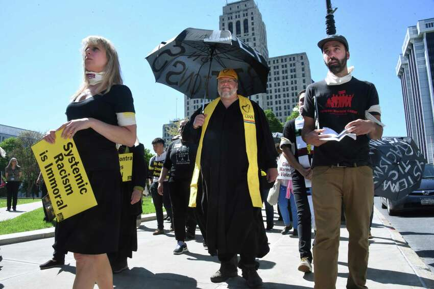 Members of the Poor People's Campaign march in connection between systemic racism, poverty and voter suppression on Monday, May 21, 2018 in Albany, N.Y. (Lori Van Buren/Times Union)