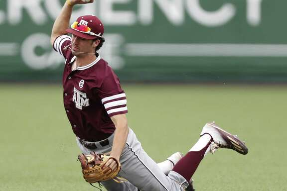 Texas A&M infielder Braden Shewmake (8) got tangled up as he tried to field a single by Houston Cougars Grayson Padgett during the ninth inning of Game 6 of an NCAA Regional baseball game at Schroeder Park, in Houston, Monday, June, 5, 2017.   ( Karen Warren / Houston Chronicle )