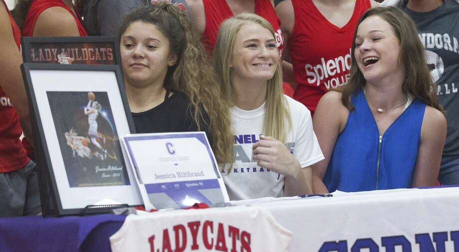 Jessica Hiltibrand shares a laugh with friends after signing to play basketball for Cornell College during a signing ceremony at Splendora High School on Thursday, May 17, 2018, in Splendora. Photo: Jason Fochtman, Staff Photographer / Houston Chronicle / © 2018 Houston Chronicle