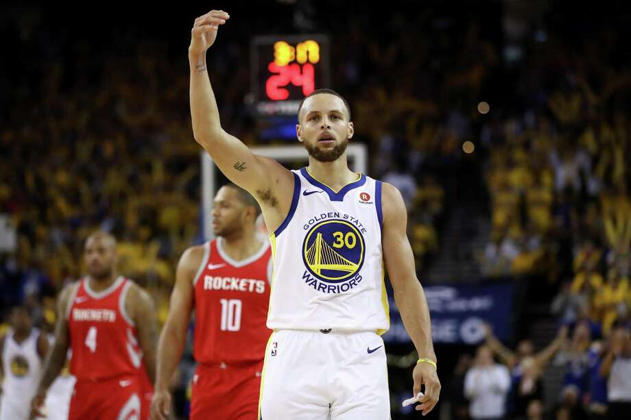 OAKLAND, CA - MAY 20:  Stephen Curry #30 of the Golden State Warriors reacts after a play against the Houston Rockets during Game Three of the Western Conference Finals of the 2018 NBA Playoffs at ORACLE Arena on May 20, 2018 in Oakland, California. NOTE TO USER: User expressly acknowledges and agrees that, by downloading and or using this photograph, User is consenting to the terms and conditions of the Getty Images License Agreement.  (Photo by Ezra Shaw/Getty Images) Photo: Ezra Shaw, Staff / Getty Images / 2018 Getty Images