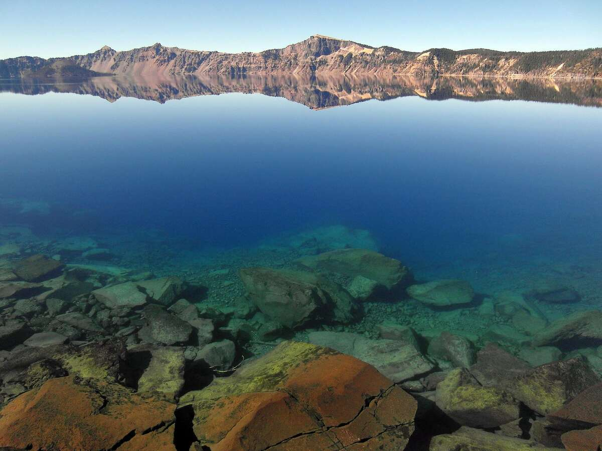 A view from the shore or Crater Lake, with Llao Rock in the distance.