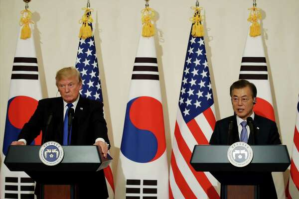 President Trump, left, listens as South Korean President Moon Jae-in speaks during a news conference in Seoul, South Korea, in November 2017. The two will meet Tuesday in Washington.