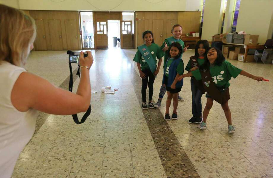 Look at these future leaders hamming it up in this photo from last year. Today is International Day of the Girl Child, and Girl Scouts of Southwest Texas is helping future leaders grow and learn. Photo: Kin Man Hui /Staff File Photo / ©2018 San Antonio Express-News