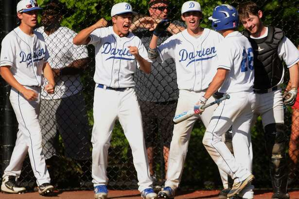 Darien players celebrate a sixth-inning run by pinch-runner Nicky Briganti on Monday.