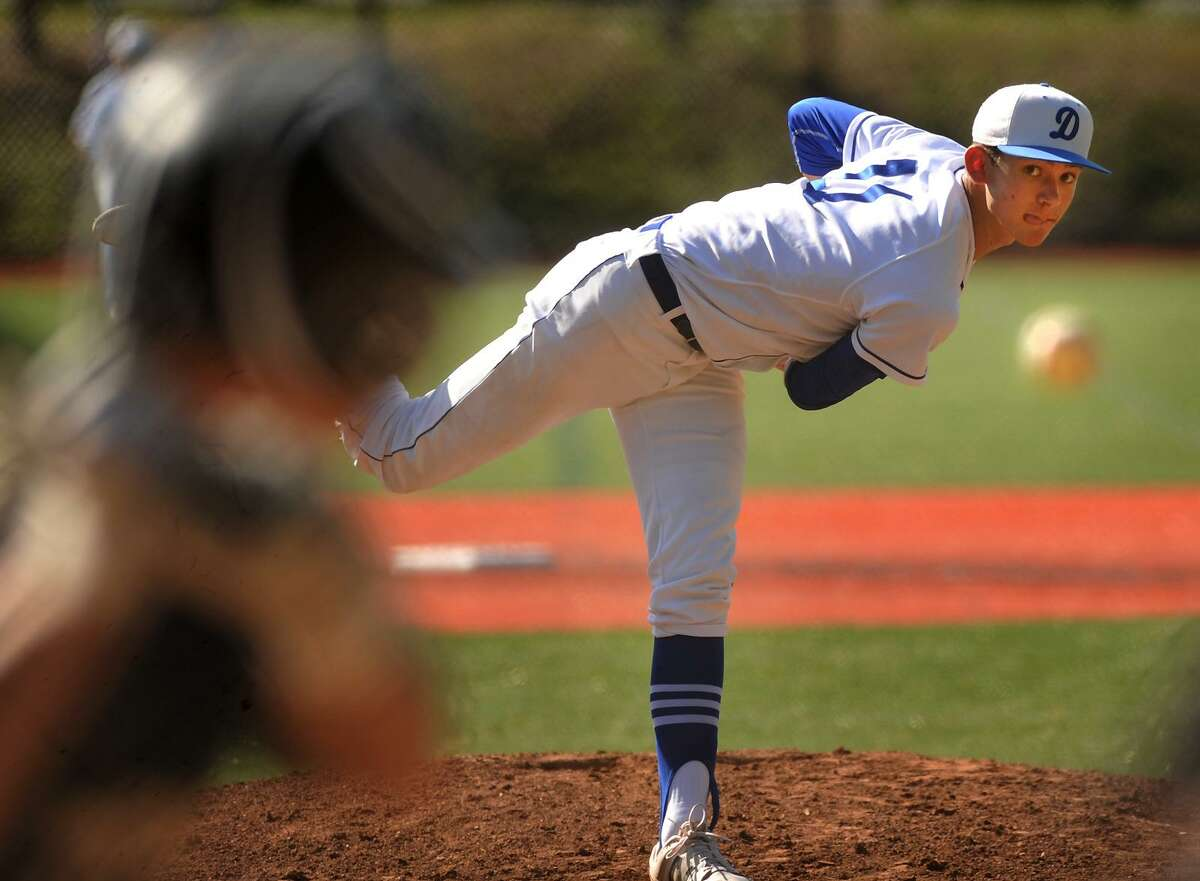 Darien pitcher Henry Williams delivers to the plate during his 1-0 complete game shutout victory over Trumbull in the FCIAC baseball quarterfinals in Darien on Monday.