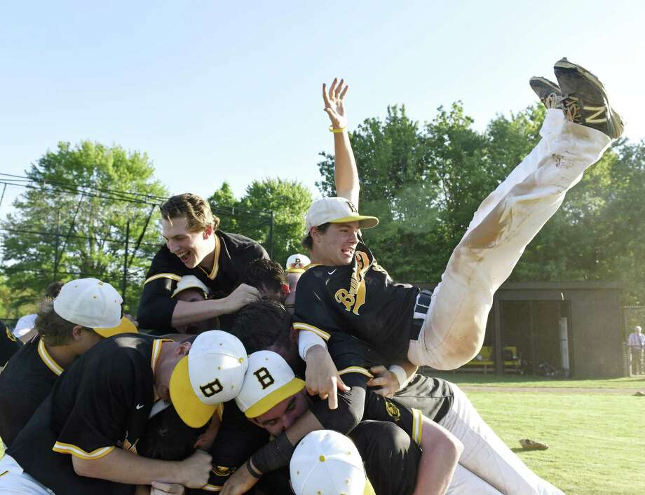 Brunswick centerfielder Marc McGuire, right, flips onto a pile of his teammates after the final out in Brunswick's 4-3 win over Hopkins in the Fairchester Athletic Association baseball championship game on Monday in Greenwich. Photo: Tyler Sizemore / Hearst Connecticut Media / Greenwich Time