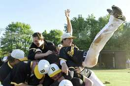 Brunswick centerfielder Marc McGuire, right, flips onto a pile of his teammates after the final out in Brunswick's 4-3 win over Hopkins in the Fairchester Athletic Association baseball championship game on Monday in Greenwich.