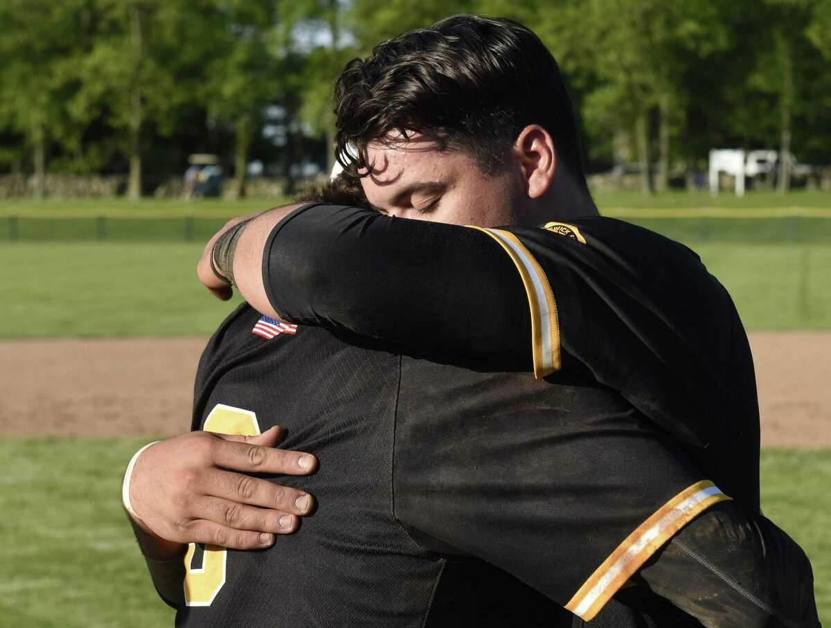 Brunswick shortstop Aaron Sabato, right, hugs pitcher Trystan Sarcone after Brunswick's 4-3 win over Hopkins in the Fairchester Athletic Association (FAA) high school baseball championship game at Brunswick School in Greenwich, Conn. Monday, May 21, 2018.