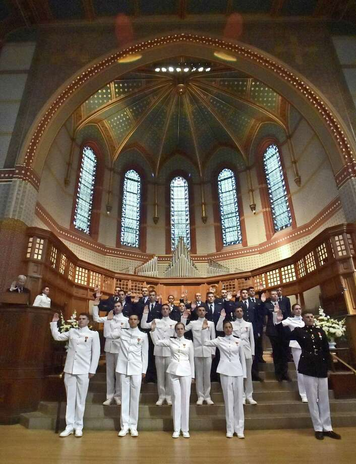 Twenty-four people were commissioned as officers in the Armed Forces Monday afternoon at Yale University's Battell Chapel in New Haven. Photo: Peter Hvizdak / Hearst Connecticut Media / New Haven Register