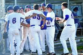 Danbury players celebrate Justin Solimine's (35) run during the Danbury versus St. Joseph's FCIAC quarterfinal baseball game at Danbury, May 21, 2018.