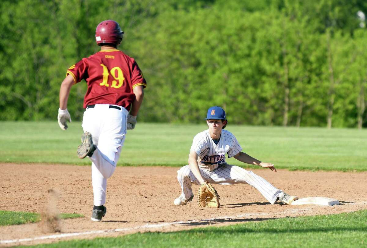 First baseman Connor Goodwin of Danbury, right, makes the play to get St. Joseph's Hadyn Gourley out during the FCIAC quarterfinal game at Danbury on Monday.