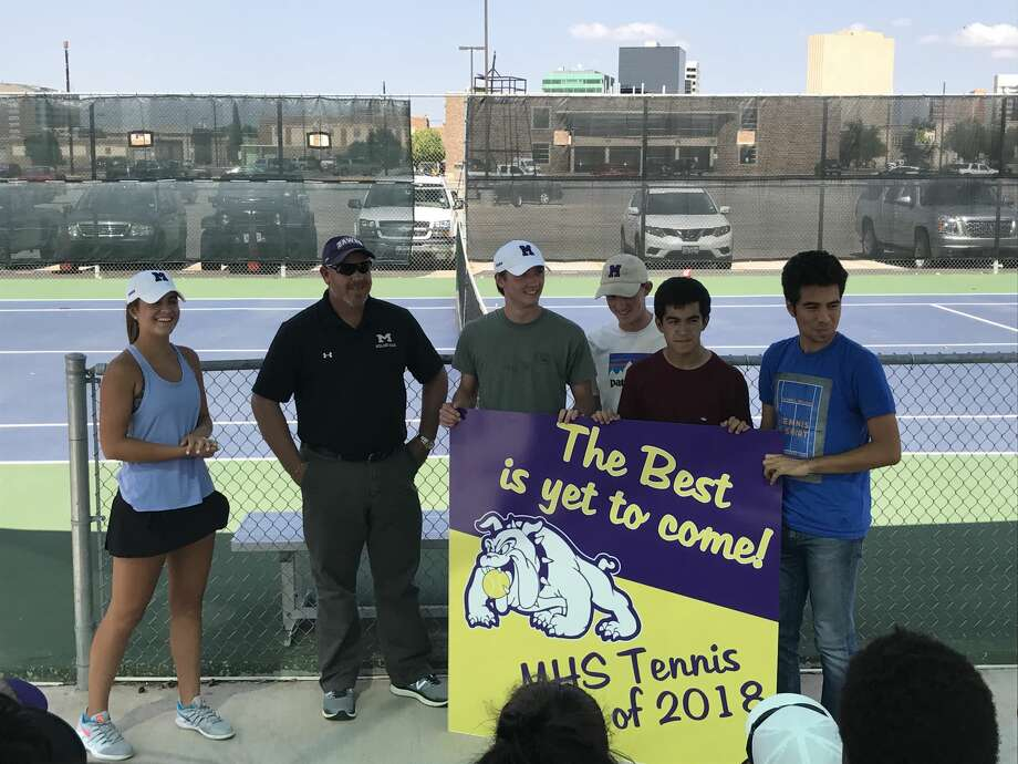 Newly hired Midland High tennis coach Tom Heiting, second from left, receives a banner from the seniors when introduced to the team Monday at the MHS tennis courts. Photo: Christopher Hadorn/Reporter-Telegram