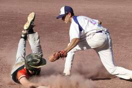 Schuylerville's Paul Harshbarger is safe at 3rd as Saratoga Central Catholic's Cadan Awad tries for the tag during Section II Class B boys' baseball quarterfinals at Veterans Memorial Field in Saratoga Springs Monday May 21, 2018. (Ed Burke - Special to The Times Union)