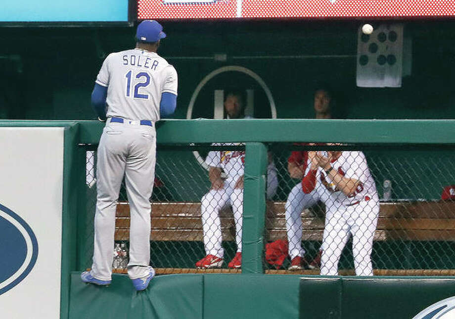 Royals right fielder Jorge Soler climbs the outfield fence as he watches a three-run home run by the Cardinals' Tyler O'Neill in the third inning of Monday night's game in St. Louis. Photo:       Jeff Roberson | AP Photo