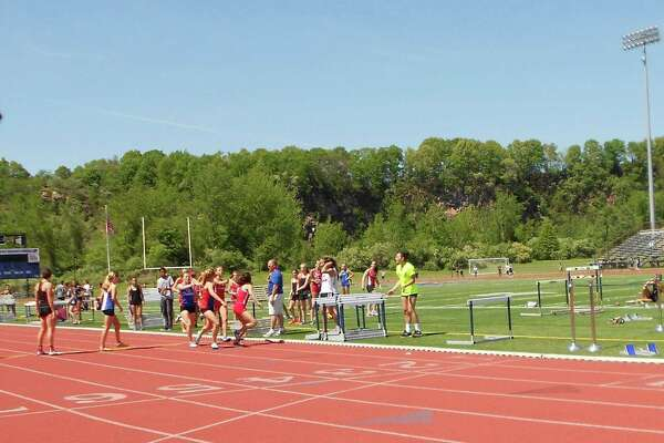 Greenwich and Danbury hand off the baton for the final leg of the girls 4x800 relay at Monday's FCIAC track and field championships at Jess Dow Field in New Haven. Greenwich won with a time of 9:26.27