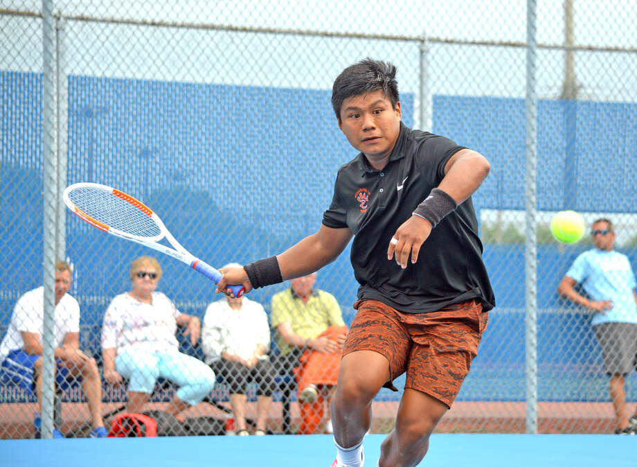 Edwardsville junior Zach Trimpe makes a forehand return during his singles semifinal against Belleville East's Christian Cowulich on Monday at the Class 2A Belleville East Sectional.