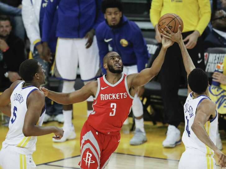 Houston Rockets' Chris Paul and Golden State Warriors' Shaun Livingston fight for a rebound in the second quarter during game 3 of the Western Conference Finals between the Golden State Warriors and the Houston Rockets at Oracle Arena on Sunday, May 20, 2018 in Oakland, Calif.