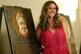 BASHOF inductee Brandi Chastain poses by her plaque. The rendering has been the subject of scorn on social media.