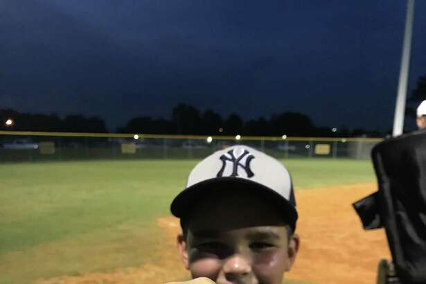 Rome Gatlin shows off his ring that he and his Yankees teammates were presented after winning the Mustang City Championship Monday night. Rome was 3-for-3 at the plate and was the winning pitcher.