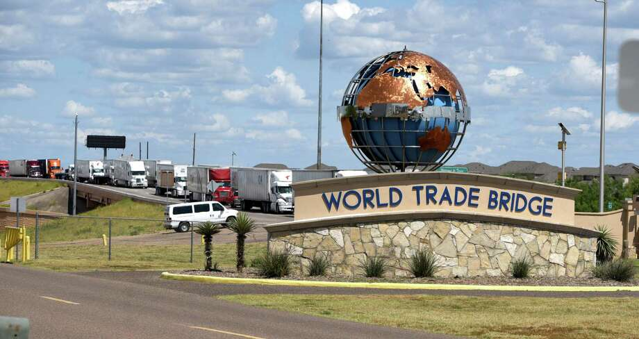 Truck traffic is shown at the World Trade Bridge in this 2018 file photo. Trump threatened to punish Mexico with tariffs until it restrains the flow of migrants. Photo: Danny Zaragoza /Laredo Morning Times / Laredo Morning Times