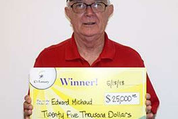 """Retired Stratford postal worker Edward Michaud holds a $25,000 check at CT Lottery headquarters in Rocky Hill on Friday, May 18, 2018. Last week, Michaud scanned his CT Lottery """"Cashword 25"""" scratch ticket in a retailer's ticket checker, he definitely received more than he expected. Anticipating a $1,000 prize for a nine-word match, the message on the checker flashed a $25,000 top prize win instead."""