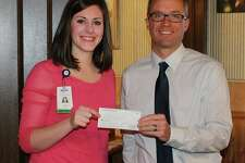 Brown City Rotary President Neil Kohler presents United Hospice Service Volunteer Coordinator Madelyn Huffman with a $3,000 check. (Submitted Photo)