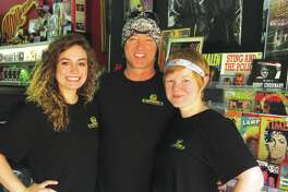 Sydney Mason, Bill Cherry, and Sara Cooper at Monster Vinyl. Cherry owns the record and collectible store, Mason is his fiance and Cooper is the store manager.