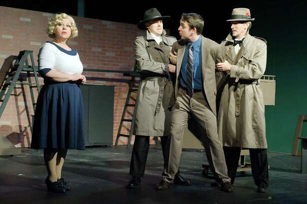 "La Porte's Jason Barron, second from left, finds himself in a pickle at times in Bay Area Harbour Playhouse's off-the-wall production of ""The 39 Steps."" The rest of the cast —, Heather Green, left, Edward Waddell and Chris Lowe — play multiple roles in the melodrama based on a 1915 novel and an Alfred Hitchcock film."