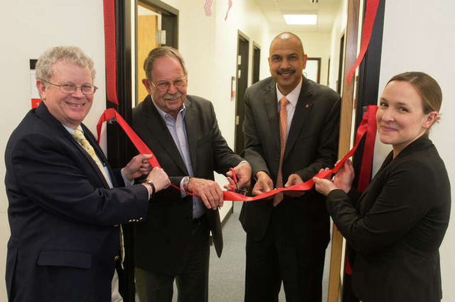 SOP Pharmacy Advisory Board officers Chris Smith, president and CEO Smith Family Holdings, Steven Peipert, Brighton Pharmacy owner, SIUE SOP Dean Gireesh Gupchup and Heather Fitzgerald, Walgreens Healthcare specialty supervisor. Photo:       For The Telegraph
