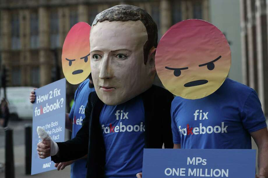 Protestors from the pressure group Avaaz demonstrate outside Portcullis house where Facebook's Chief Technology Officer Mike Schroepfer is to be questioned by members of parliament in London on April 26, 2018. The New York Time's decided to conduct a privacy experiment: Request our data in both Britain and the United States, to get a sense of how easy it will be for people in Europe to access their personal information compared with people in the United States. Photo: DANIEL LEAL-OLIVAS /AFP /Getty Images / AFP or licensors