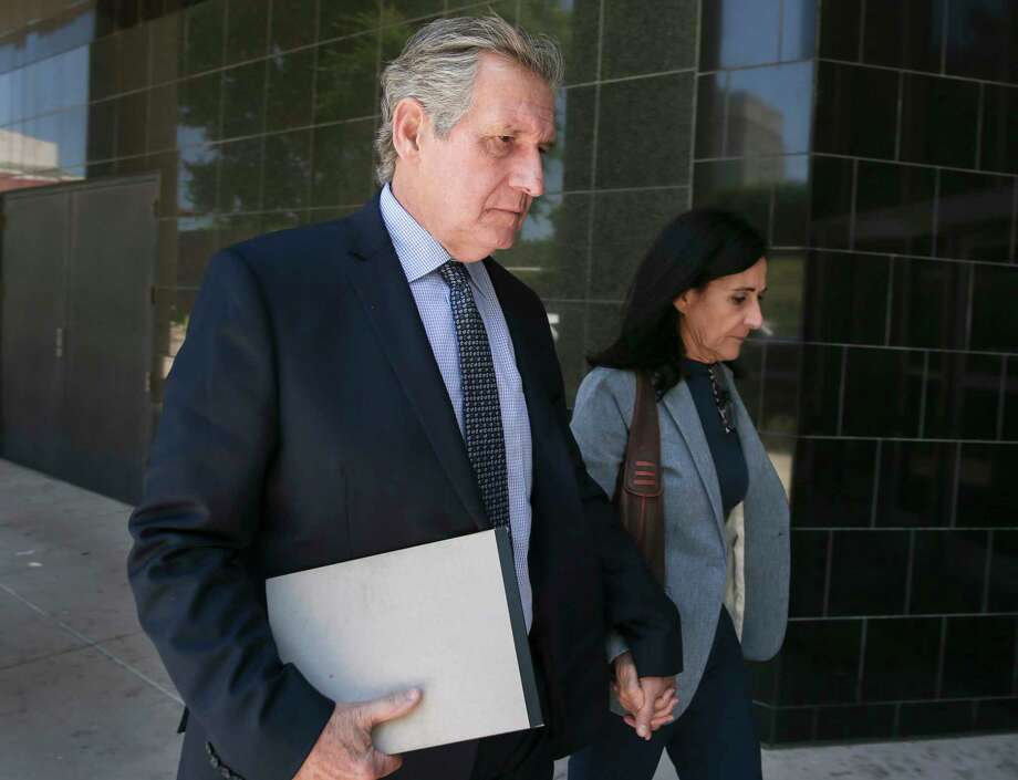 Carlos and Jemima Guimaraes walk into into the United States District Courthouse building on Wednesday, May 16, 2018, in Houston. The Guimaraes are on trial for conspiracy to abduct their grandson, Nico Brann. The 8-year-old boy has been living in Brazil since his mother took him there for a wedding in 2013, although she and his father had been granted split custody. Photo: Yi-Chin Lee, Houston Chronicle / © 2018 Houston Chronicle