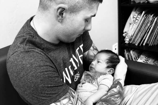 U.S. Army sergeant Steven Garcia and the baby in a photo posted to their GoFundMe page.