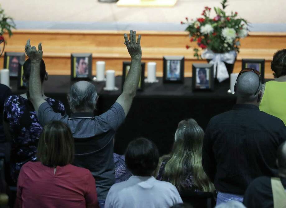 A church member prays during a prayer service at Crosby Church, Monday, May 21, 2018, in Crosby, for Christian Riley Garcia, one of the students killed, Friday at Santa Fe High School, who grew up in the church.  ( Karen Warren  / Houston Chronicle ) Photo: Karen Warren, Staff / Houston Chronicle / © 2018 Houston Chronicle